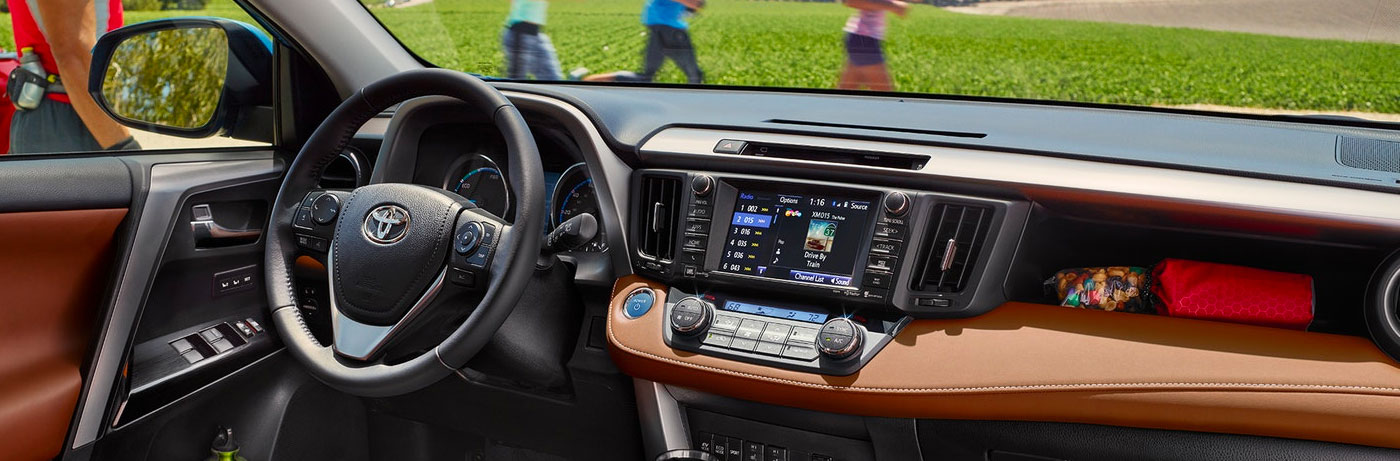 Limited Hybrid interior shown in Cinnamon with available Entune Premium JBL Audio with Integrated Navigation and App Suite