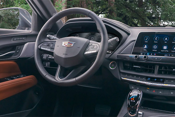 Interior shot of the driver's seat in a Cadillac