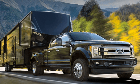2018 Ford Super Duty Platinum Crew Cab with 5th-wheel hitch towing heavy trailer