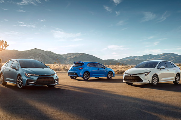 2021 Toyota Corolla Hybrid models parked in an open lot