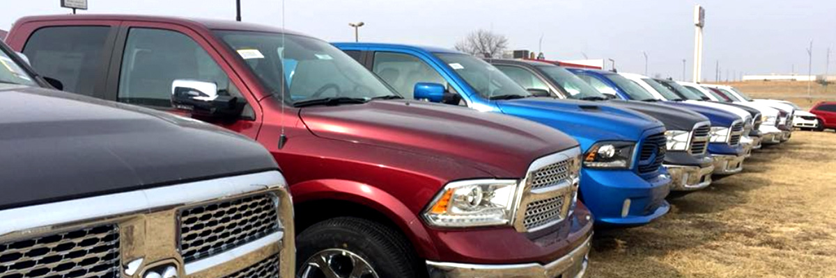 Lineup of Ram trucks outside the dealership