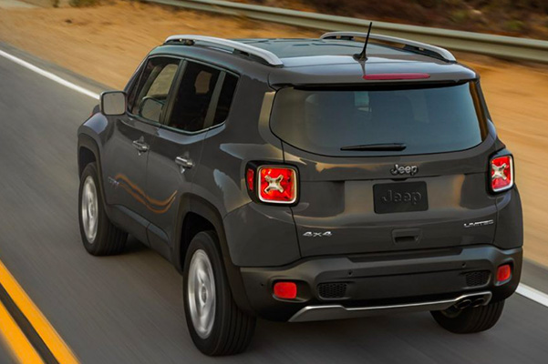 Rear view of a 2020 Jeep Renegade driving away