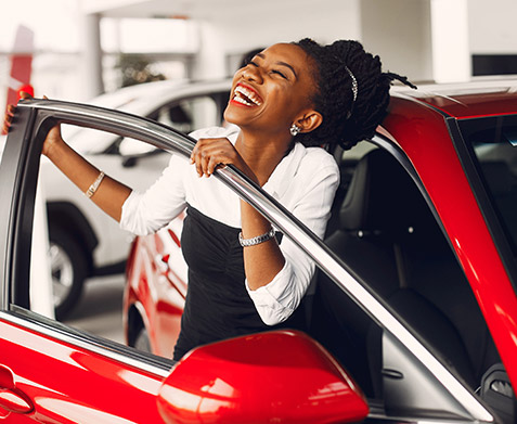 Woman excited about a new car
