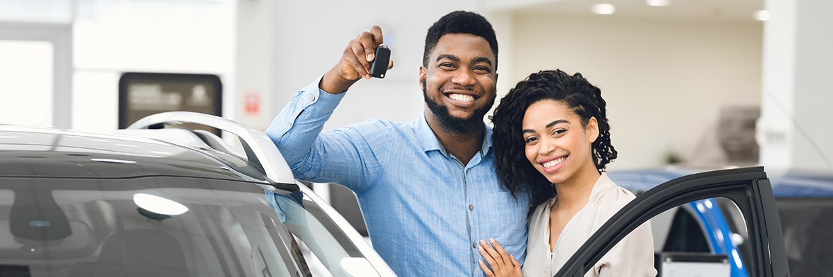 Couple holding new car keys