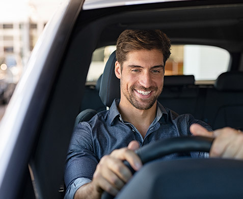 Man smiling behind the wheel